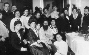 Rasputin in the center surrounded by his admirers in St. Petersburg, 1914.