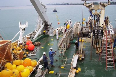 Installation of submarine communications cable in progress.