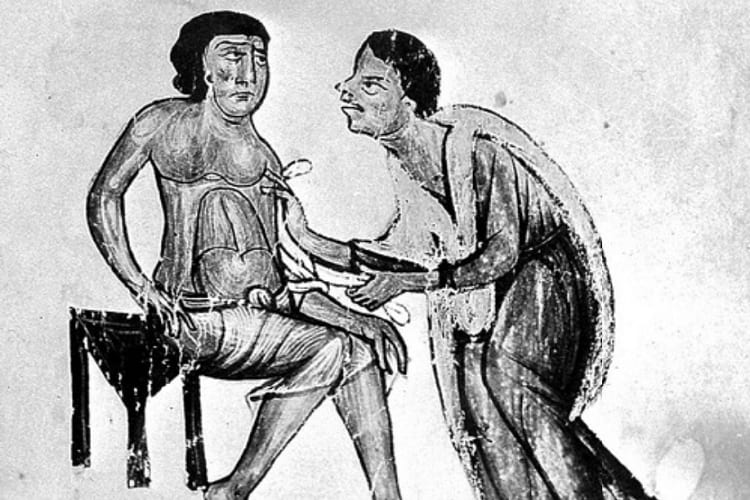 A physician attempting to cure a patients stomach ailment.