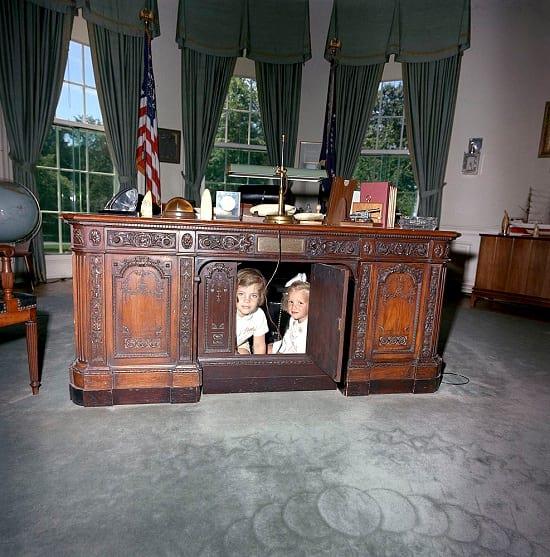 Caroline and & Kerry Kennedy hiding inside the Resolute desk.