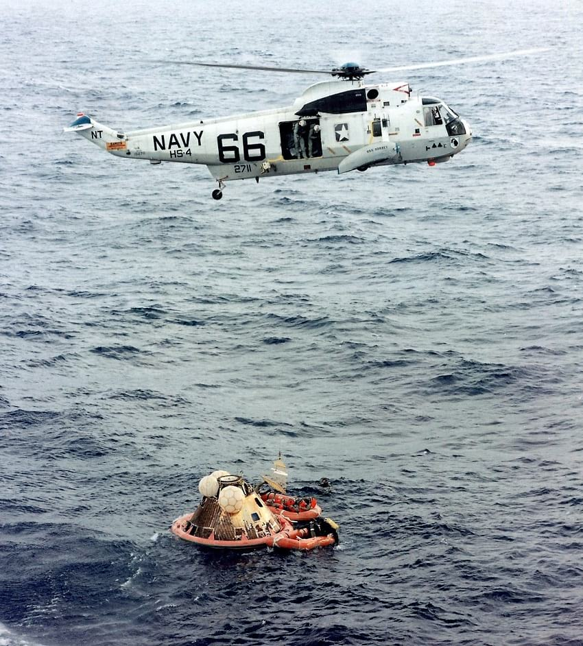 Helicopter 66 above Apollo 11 capsule.