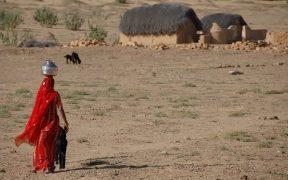 A women carrying water