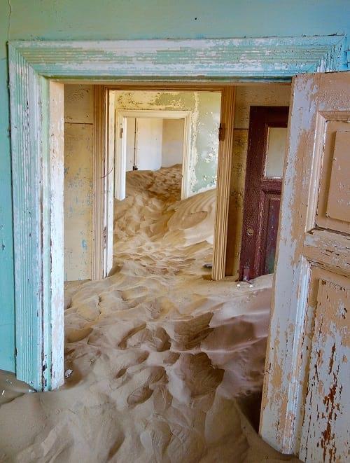 Kolmanskop: A house engulfed by dune.