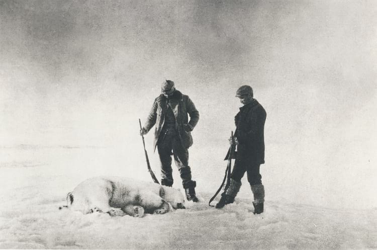Members of the Andrée expedition with a freshly killed polar bear.