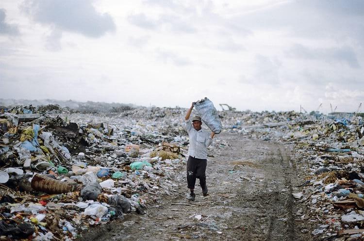 A worker carrying rubbish inside the Thilafushi island.