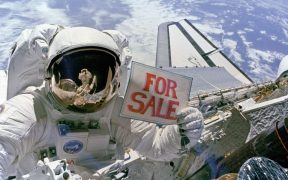 "NASA astronaut holding a ""For Sale"" sign for the satellites."