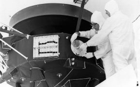 Scientist mounting Golden Records on Voyager spacecraft.