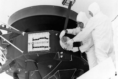Scientist mounting Golden Records on Voyager spacecraft.