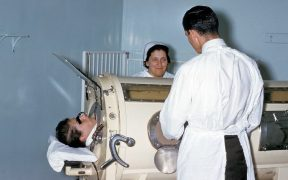 A patient in Iron lung.