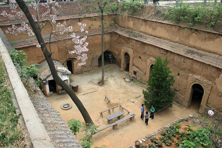 A sunken courtyard type cave dwelling.