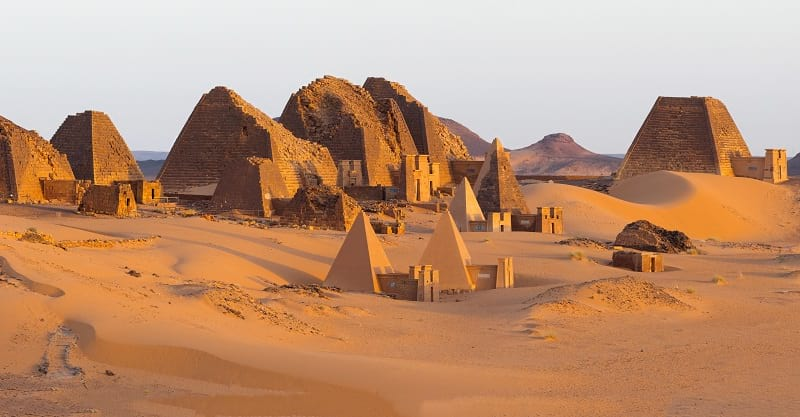 The Pyramids of Sudan form a distant.
