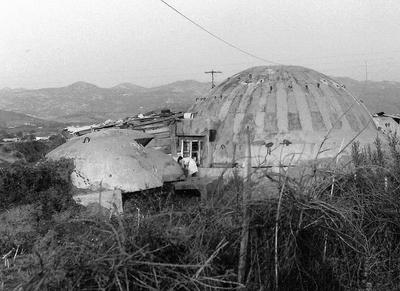 A PZ bunker converted into home by a poor family.