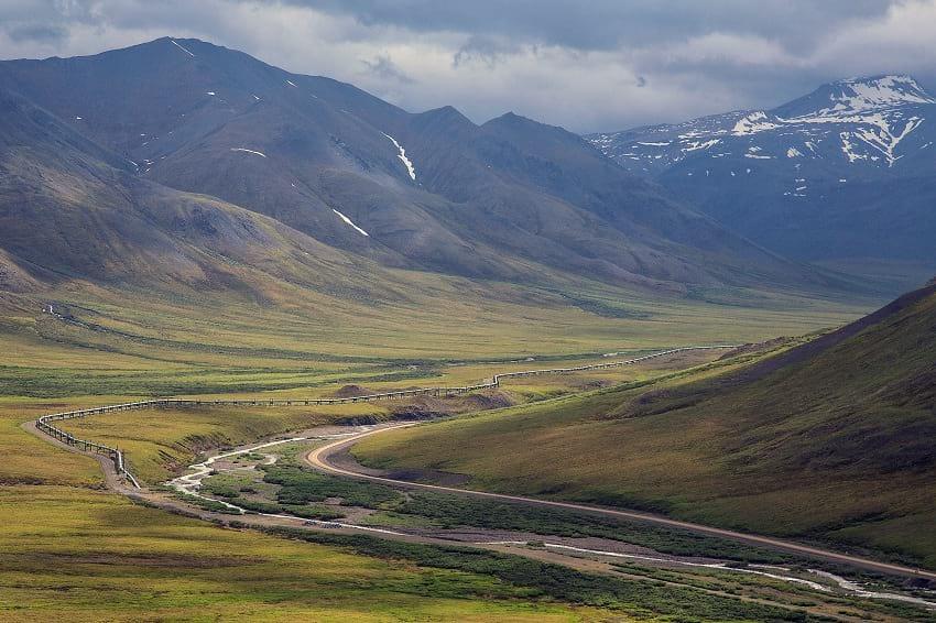 The Trans-Alaska Pipeline against a beautiful landscape.