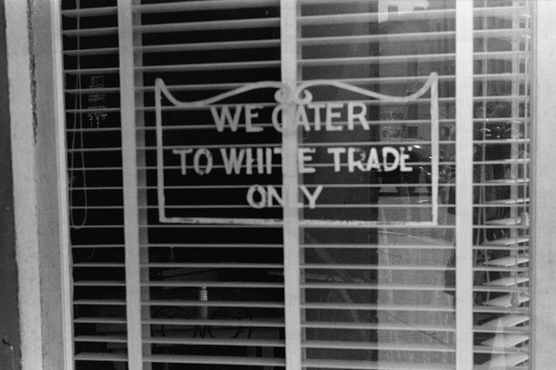 """A sign on a restaurant: """"We Cater to White Trade only."""""""