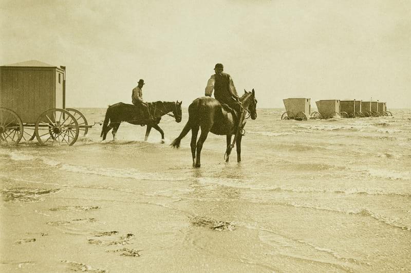 Horsemen moving bathing machine